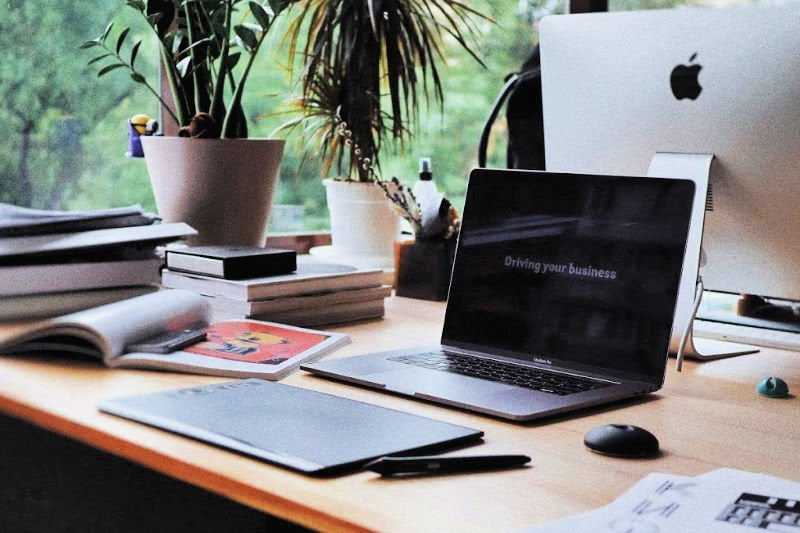 photo of a desk with piles of paper