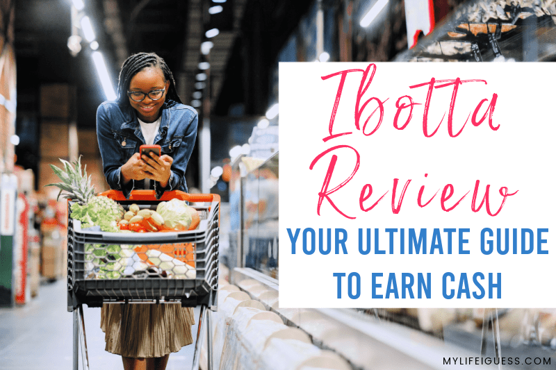 woman grocery shopping in store and looking at her phone with the text Ibotta Review - Your 2020 Guide To Earn Cash