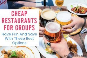 a table full of food with people cheers-ing their glasses with the text Cheap Restaurants For Groups - Have Fun And Save With These Best Options