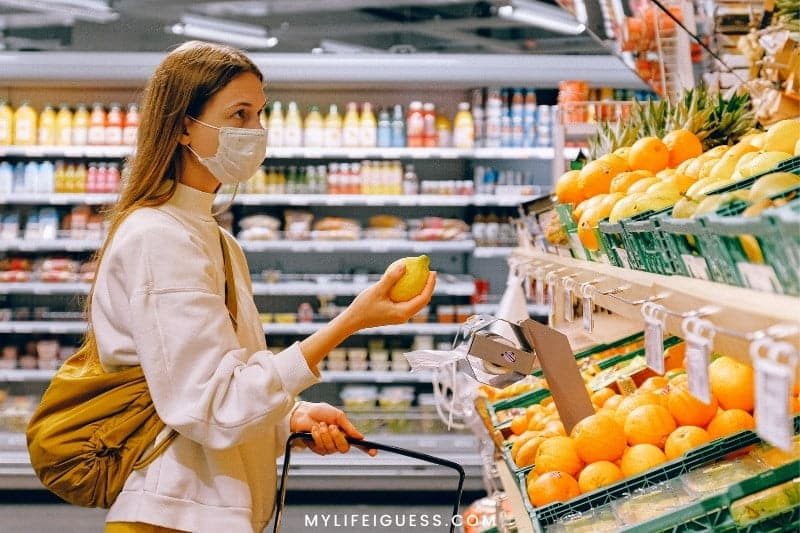 woman with face mask grocery shopping