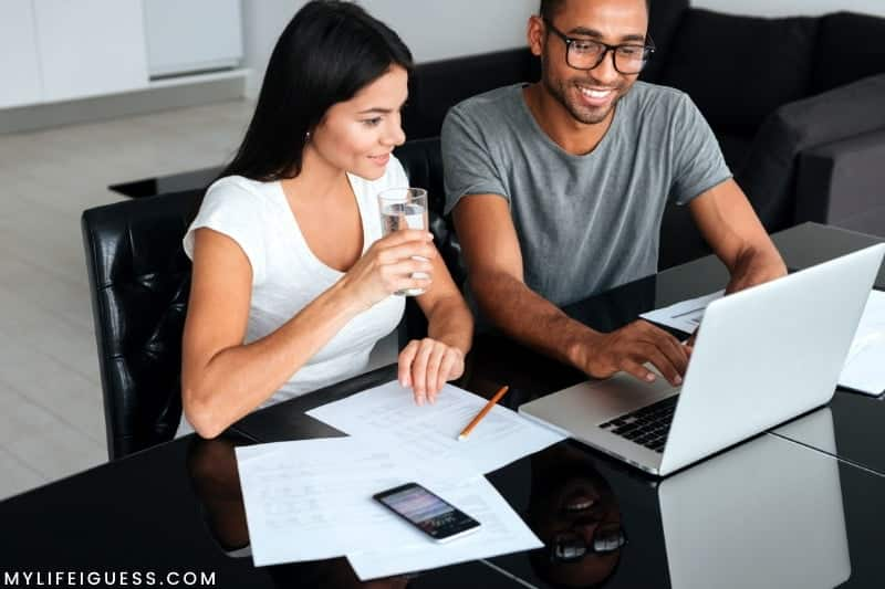 a couple looking at their finances with the text The Best Safe Investments With High Returns
