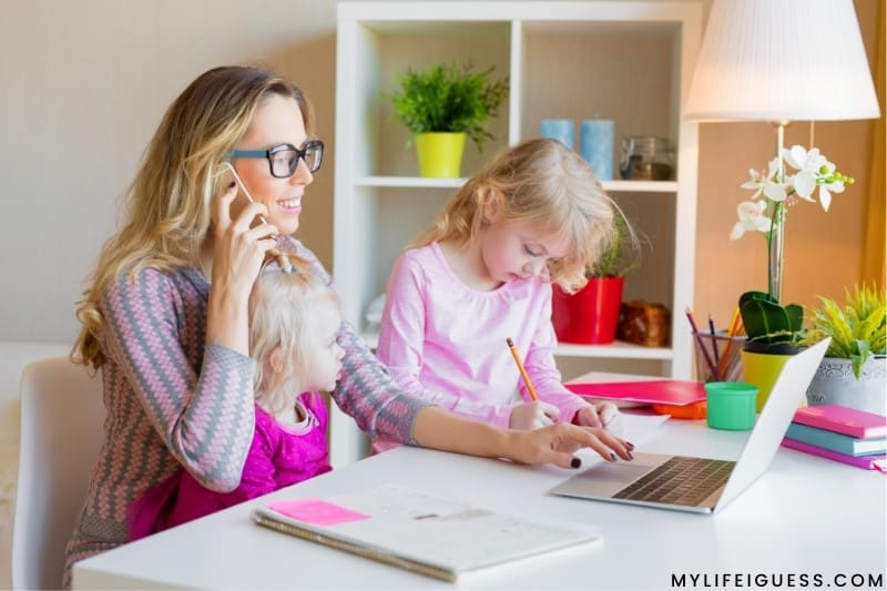 a mom working from home with her 2 children