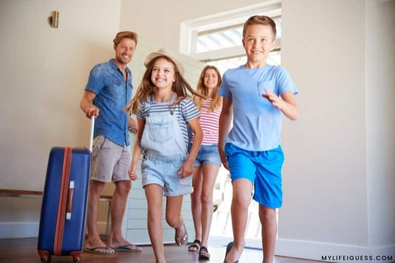 a family entering a vacation rental