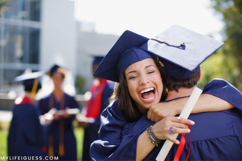 new graduates hugging in celebration