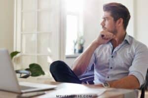 a man sitting at a desk thinking