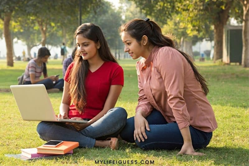 two college students studying on the grass